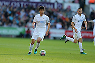 Ki Sung-Yueng of Swansea city in action . Premier league match, Swansea city v Watford at the Liberty Stadium in Swansea, South Wales on Saturday 22nd October 2016.<br /> pic by  Andrew Orchard, Andrew Orchard sports photography.