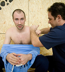 Vid Kavticnik and physiotherapist Sokol Kadrija at Open training session for the public of Slovenian handball National Men team before European Championships Austria 2010, on December 27, 2009, in Terme Olimia, Podcetrtek, Slovenia.  (Photo by Vid Ponikvar / Sportida)