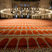 Inside the prayer hall of Suleymaniye Mosque in Istanbul, ornately decorated in the imperial Ottoman style. Dedicated to Suleiman the Magnificent (or Suleiman I), the longest-reigning Ottoman Sultan (1520-1566), Süleymaniye Mosque stands prominently on Istanbul's Third Hill and is considered the city's most important mosque. It was completed in 1558.