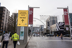 © Licensed to London News Pictures. 18/01/2021. LONDON, UK. Signage directs the public to a vaccination centre at the Olympic Office Centre in Wembley, north London.  This is one of ten new mass Covid vaccination centres opening today and they join the seven already in use across the country.  So far, 3.8 million people across the UK have received a first dose and the government hopes that number to rise to 15 million by 15 February.  Photo credit: Stephen Chung/LNP