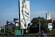 A outdoor billboard of supermodel Giselle Bunchen advertising lingerie, overlooks Marrey maximum securty prison, Guarulhos. Brazil.