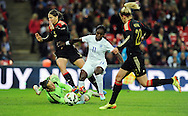 Eniola Aluko of England Women is challenged by Germany Women goalkeeper Almuth Schult<br /> - Womens International Football - England vs Germany - Wembley Stadium - London, England - 23rdNovember 2014  - Picture Robin Parker/Sportimage