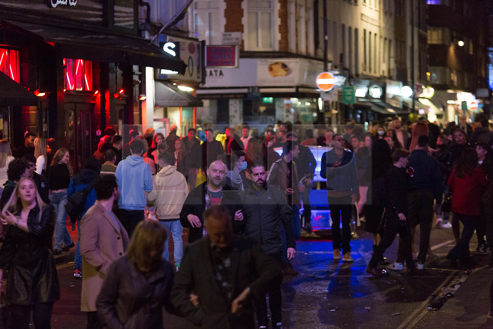 © Licensed to London News Pictures. 22/05/2021. London, UK. Revellers make the most of Saturday night in Soho, central London as easing of lockdown restriction continues. Photo credit: Marcin Nowak/LNP