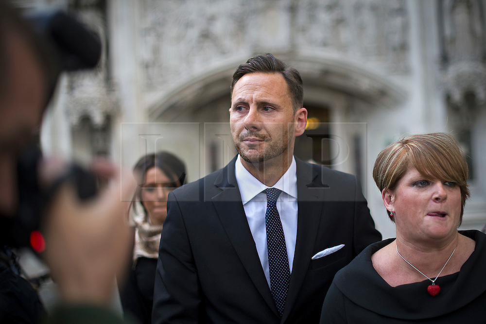 © London News Pictures. 08/05/2012. London, UK. GLENN MULCAIRE (centre) and his wife ALISON MULCAIRE (right) leaving the Supreme Court in London on May 8, 2012 where GLENN MULCAIRE has begun an appeal  against a High Court order compelling him to provide details of the News of the World employee who commissioned him to hack the phone of Nicola Philips, a former publicist for Max Clifford. Mr Mulcaire is the former private detective who served a prison sentence for phone hacking in 2007. He carried out illegal voicemail interceptions for the News Of The World newspaper. Photo credit: Ben Cawthra/LNP