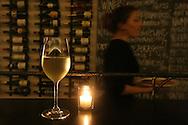 A glass of Hüpler Gruner Veltliner, an Austrian white, sits on a bar at Red + White Wine Bar in the Glen Park neighborhood of San Francisco, CA Friday night, February 26, 2010.