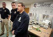 Left to right, Lt. Justin Hoyal, Chief Jon Fassett and Sgt. Evan Mallas speak to the media at the Unified Police Department Evidence and Special Operations Building following an impressive drug bust in Magna that yielded over 43 pounds of marijuana and $67,000 in cash, Friday, Jan. 4, 2013.