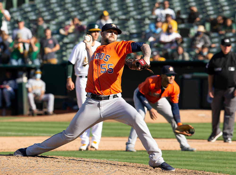 Sep 26, 2021; Oakland, California, USA; Houston Astros pitcher Ryan Pressly (55) delivers a pitch against the Oakland Athletics in the ninth inning at RingCentral Coliseum. Mandatory Credit: D. Ross Cameron-USA TODAY Sports