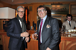 Left to right, PERRY OOSTING and JOHN AYTON at the Johnnie Walker Blue Label and David Gandy partnership launch party held at Annabel's, 44 Berkeley Square, London on 5th February 2013.