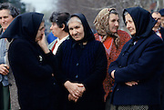 Croatian women escape the fighting in Yugoslavia as refugees in Hungary, wearing traditional widow's black clothing