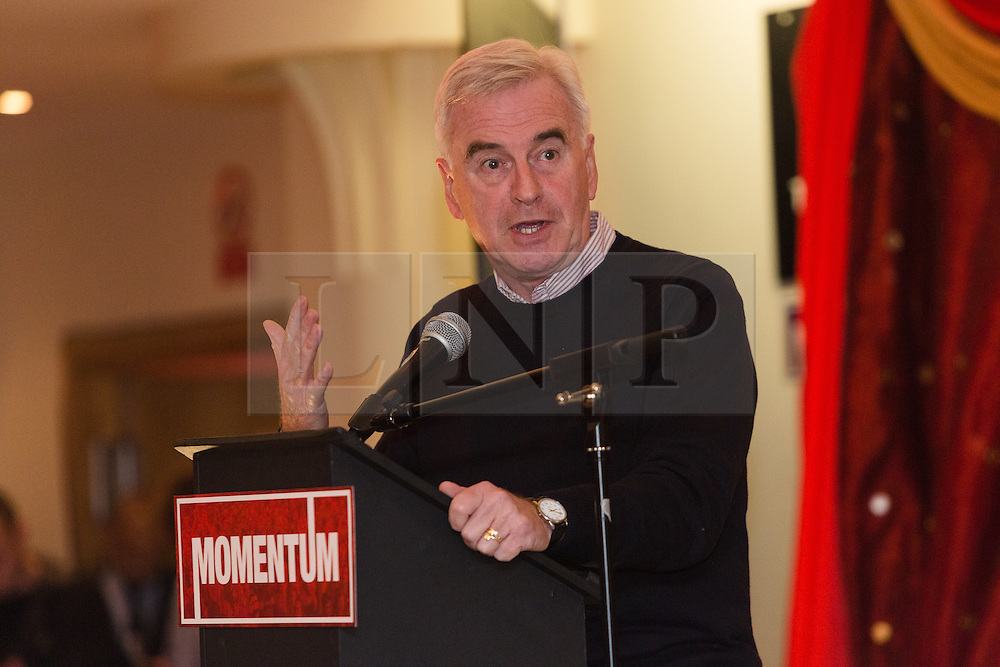 © Licensed to London News Pictures. 24/10/2015. London, UK. Shadow Chancellor,  John McDonnell applauding speakers at the Labour Party Momentum event held at the Waterlilly in Whitechapel, east London. Momentum is a new successor entity to the Jeremy Corbyn for Labour Leader campaign which works with people who supports Corbyn's aim of creating a more fair, equal and democratic society. Photo credit : Vickie Flores/LNP/10/2015. London, UK. Shadow Chancellor,  John McDonnell speaking at the Labour Party Momentum event held at the Waterlilly in Whitechapel, east London. Momentum is a new successor entity to the Jeremy Corbyn for Labour Leader campaign which works with people who supports Corbyn's aim of creating a more fair, equal and democratic society. Photo credit : Vickie Flores/LNP