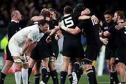 © Andrew Fosker / Seconds Left Images 2011 - The All Blacks celebrate winning the World cup at the final whistle as France's Lionel Nallet sags with hand on knees (L)  France v New Zealand - Rugby World Cup 2011 - Final - Eden Park - Auckland - New Zealand - 23/10/2011 -  All rights reserved..