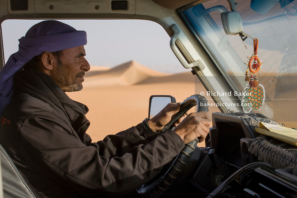 A Bedouin drives his 4x4 vehicle through desert sand dunes at al-Galamun, near Dahkla Oasis, Western Desert, Egypt. The past few decades have been difficult for traditional Bedouin culture due to changing surroundings and the establishment of new resort towns on the Red Sea coast, such as Sharm el-Sheikh. Bedouins in Egypt are facing a number of challenges: erosion of traditional values, unemployment, and various land issues. The Western Desert covers an area of some 700,000 km2, thereby accounting for around two-thirds of Egypt's total land area. Dakhla Oasis is one of the seven oases of Egypt's Western Desert (part of the Libyan Desert). It lies in the New Valley Governorate, 350 km (220 mi.) and measures approximately 80 km (50 mi) from east to west and 25 km (16 mi) from north to south.