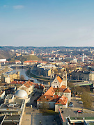 High-angle view of Old Town Vilnius, Lithuania, with the Neris River running through town.