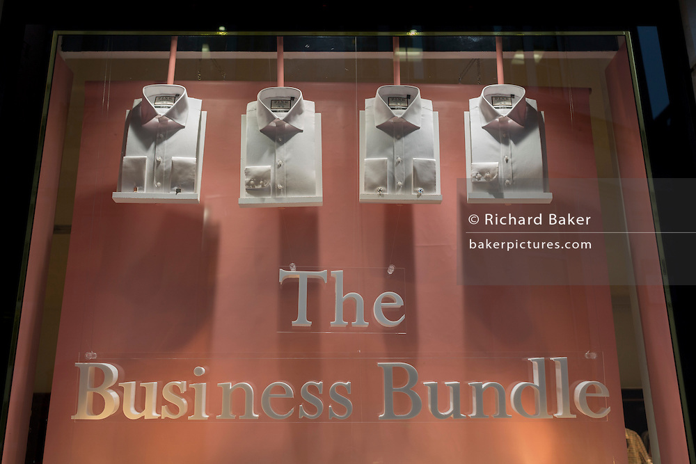 Formal shirts bundle on display in the window of City menswear retailer Pink, on 9th February 2017, in the City of London, England.