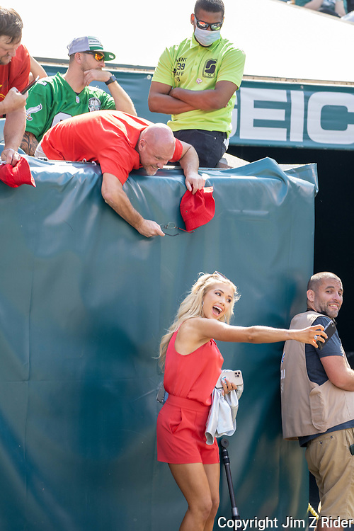 """GRACELYN """"GRACIE"""" HUNT, Miss Kansas USA, 2021, takes a selfie with Kansas City fans before an NFL football game between the Philadelphia Eagles and the Kansas City Chiefs at Lincoln Financial Field in Philadelphia, Pennsylvania.  HUNT is the daughter of Chiefs part owner and CEO Clark Knobel Hunt. The Chiefs won 42-30."""