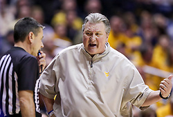 Feb 12, 2020; Morgantown, West Virginia, USA; West Virginia Mountaineers head coach Bob Huggins argues a call with a referee during the second half against the Kansas Jayhawks at WVU Coliseum. Mandatory Credit: Ben Queen-USA TODAY Sports