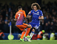 Chelsea's David Luiz tussles with Manchester City's Raheem Sterling during the Premier League match at the Stamford Bridge Stadium, London. Picture date: April 5th, 2017. Pic credit should read: David Klein/Sportimage