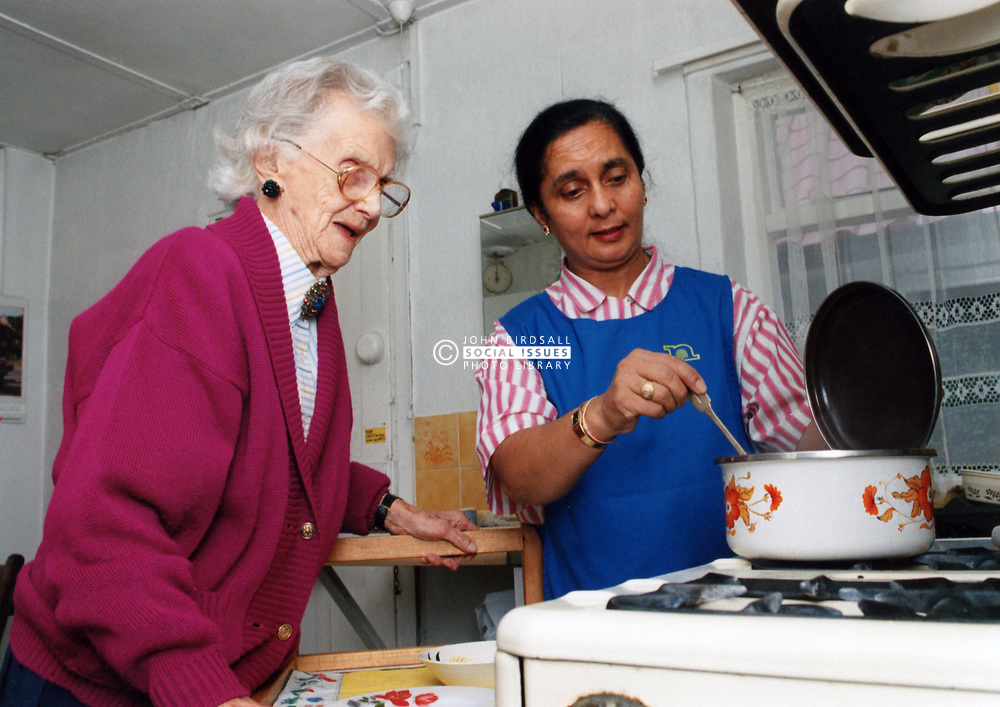 Carer and elderly woman, UK