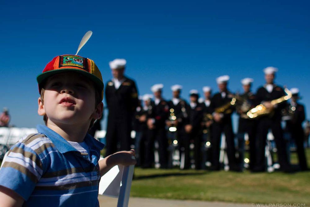 Ezra Gualtieri watches Navy Band Southwest between performances during a special ceremony for the late actor Jimmy Stewart on Mt. Soledad in La Jolla, California on November 08, 2008.
