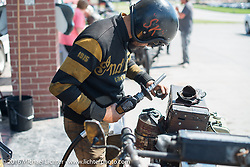 Shinya Kimura gases up his 1915 Indian during the Motorcycle Cannonball Race of the Century. Stage-8 from Wichita, KS to Dodge City, KS. USA. Saturday September 17, 2016. Photography ©2016 Michael Lichter.