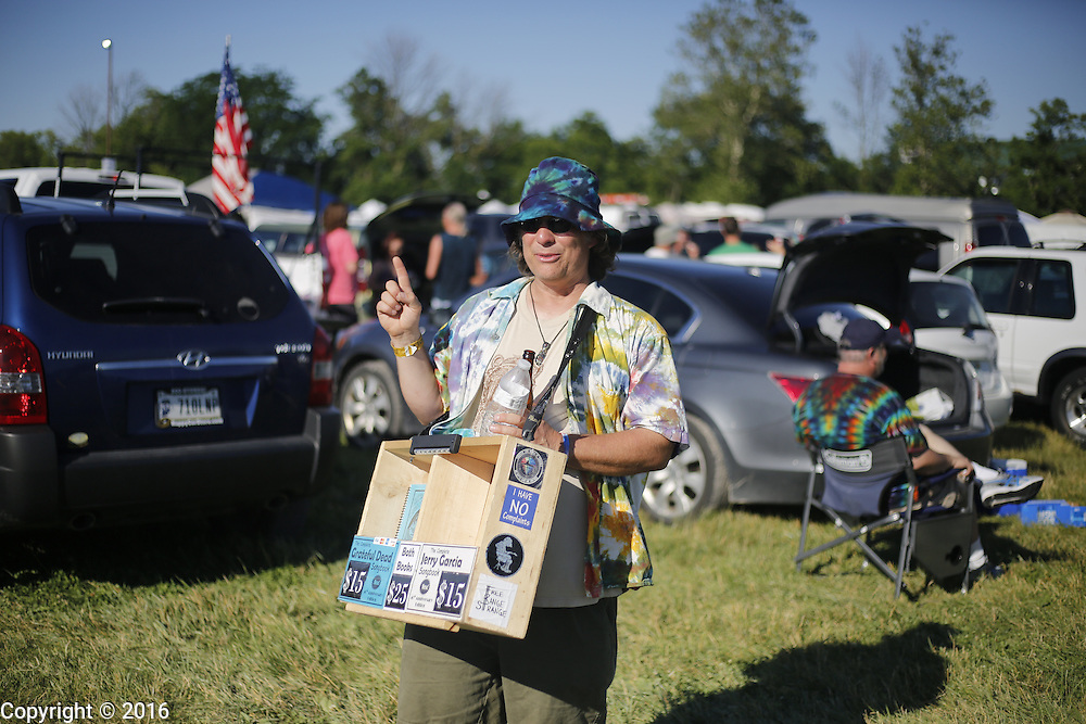 06212016 - Noblesville, Indiana, USA: A deadhead puts his finger up hoping to get a miracle ticket in the parking lot of Klipsch Music Center (Deer Creek) before members of the Grateful Dead perform as Dead and Company. The Grateful Dead's final show at  Deer Creek in July 1995 was marred by over a thousand fans crashing the gates leading to the next day's show being canceled. Grateful Dead guitarist Jerry Garcia died a few weeks later. (Jeremy Hogan/Polaris)