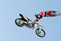 """Jul 01, 2003; Anaheim, California, USA; Moto X star athlete CHUCK CAROTHERS catches reverse air at Disney's California Adventure """"X Games Experience"""".  <br />Mandatory Credit: Photo by Shelly Castellano/Icon SMI<br />(©) Copyright 2003 by Shelly Castellano"""