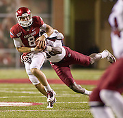 Nov 5, 2011; Fayetteville, AR, USA;  Arkansas Razorback quarterback Tyler Wilson (8) is brought down by South Carolina Gamecocks defensive end Devin Taylor (98) during a game at Donald W. Reynolds Stadium.  Mandatory Credit: Beth Hall-US PRESSWIRE
