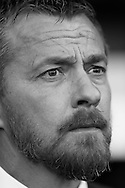 Image converted to b/w. Slavisa Jokanovic, the Fulham manager looks on from the dugout .Skybet EFL championship match, Fulham v Newcastle Utd at Craven Cottage in Fulham, London on Friday 5th August 2016.<br /> pic by John Patrick Fletcher, Andrew Orchard sports photography.