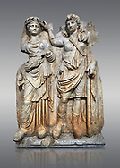 Roman Sebasteion relief  sculpture of Aphrodite crowned by Andreia, Aphrodisias Museum, Aphrodisias, Turkey. <br /> <br /> A draped goddess is crowned by a female warrior figure. The goddess is probably Aphrodite, while the warrior has a bare breated Amazonian dress and equipment (spear, sword strap and shield) worn by Roma or Andreia (Bravery) .<br /> <br /> If you prefer to buy from our ALAMY STOCK LIBRARY page at https://www.alamy.com/portfolio/paul-williams-funkystock/greco-roman-sculptures.html . Type -    Aphrodisias     - into LOWER SEARCH WITHIN GALLERY box - Refine search by adding a subject, place, background colour, museum etc.<br /> <br /> Visit our ROMAN WORLD PHOTO COLLECTIONS for more photos to download or buy as wall art prints https://funkystock.photoshelter.com/gallery-collection/The-Romans-Art-Artefacts-Antiquities-Historic-Sites-Pictures-Images/C0000r2uLJJo9_s0