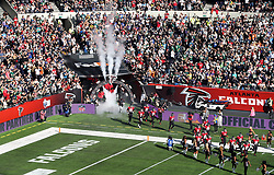 Atlanta Falcons players run onto the pitch for the match which is part of the NFL London Games at Tottenham Hotspur Stadium, London. Picture date: Sunday October 10, 2021.