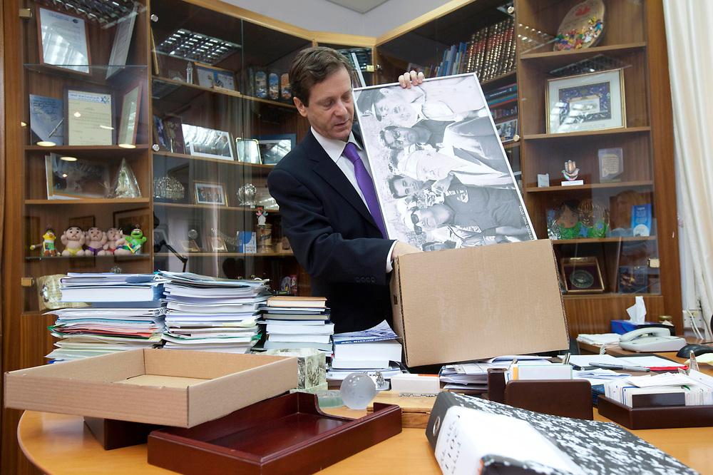 Outgoing Welfare and Social Services Minister Isaac Herzog packs his belongings at the Welfare Ministry in Jerusalem on January 18, 2011, following his resignation from the Israeli government yesterday.