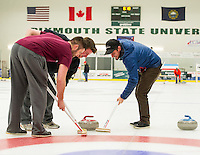 Chad Hecht, Matt Cann and Klint Skelly sweep to get their stone in the house for Team Rock Blockers during Curling League play Thursday evening at the Plymouth State University Ice Arena.  (Karen Bobotas/for the Laconia Daily Sun)