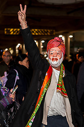 © Licensed to London News Pictures. 13/11/2015. London, UK. A pro Modi supporter, wearing a Modi mask, taunts pro Kashmiri supporters outside Wembley Stadium after Indian Prime Minister Modi was special guest at a gathering for 55,000 British Indians inside the stadium. Photo credit : Stephen Chung/LNP