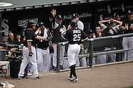 CHICAGO - JULY 11:  Andruw Jones #25 is greeted by bench coach Joey Cora #28 (arm raised) and manager Ozzie Guillen #13 of the Chicago White Sox after Jones hit his 400th career home run off of Anthony Lerew #54 of the Kansas City Royals in the third inning on July 11, 2010 at U.S. Cellular Field in Chicago, Illinois.  The White Sox defeated the Royals 15-5.  (Photo by Ron Vesely)