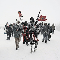 """The award-winning photograph """"No Spiritual Surrender,"""" by Zoe Urness will be one of the featured photographs in the """"Beyond Standing Rock"""" art exhibition at the Museum of Indian Arts and Culture in Santa Fe. The exhibit opens Saturday and will run through Oct. 27.<br />  <br /> Courtesy Photo<br /> Kathy Whitman Elk Woman's sculpture, """"Choosing Oil Over Water… Water is Sacred,"""" will be featured in the Museum of Indian Arts and Culture's upcoming art exhibit """"Beyond Standing Rock."""" The exhibit opens Saturday and will run through Oct. 27."""
