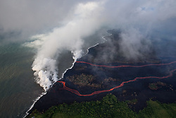 2018 05 24 - Pahoa, Hawaii, USA:  Two rivers of lava  enter the sea this morning, as multiple fissure eruptions supplied a tremendous volume of molten material, and the interaction between the cold seawater and 2000 degree lava create a toxic gas plume of laze.  Consisting of hydrochloric acid, steam, and tiny bits of volcanic glass, this mixture irritates and burns, and can cause respiratory issues.<br />Photo: ZUMA/Bruce Omori/Paradise Helicopters