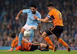 Manchester City's Ilkay Gundogan and Wolverhampton Wanderers' Danny Batth (right) battle for the ball