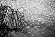 A bench in Santi Chai Prakan Public Park is partly submerged after heavy rains sent the Chao Phraya River over its banks in Bangkok, Thailand. (November 19, 2011)