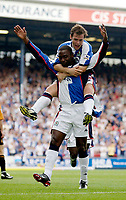 Photo. Jed Wee<br /> Blackburn Rovers v Wolverhampton Wanderers, FA Barclaycard Premiership, Ewood Park, Blackburn. 16/08/2003.<br /> Blackburn's David Thompson jumps on the shoulders of team mate Andy Cole after his first goal.