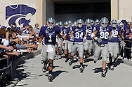 MANHATTAN, KS - NOVEMBER 17:  Quarterback Josh Freeman #1 and Linebacker Ian Campbell #98 of the Kansas State Wildcats lead the Wildcats onto the field before a game against the Missouri Tigers on November 17, 2007 at Bill Snyder Stadium in Manhattan, Kansas.  Missouri won the game 49-32.  (Photo by Peter Aiken/Getty Images)