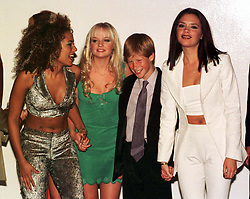Prince Harry, youngest son of Britain's Prince of Wales and the late Diana Princess of Wales, enjoys the company of Spice Girls (l/r) Mel B, Emma and Victoria, when the young prince met the female entertainers while attending their concert in Johannesburg, South Africa.