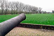 Nederland, Ravenstein, 13-4-2018Een vestingstadje aan de Maas, in de gemeente Oss, in de Nederlandse provincie Noord-Brabant . De historische binnenstad telt verschillende rijksmonumenten . Middeleeuwse kanonnen aan de dijk herinneren aan vroeger tijden .Foto: Flip Franssen