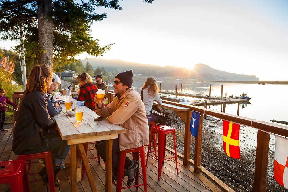 The Outdoor deck, overlooking Nehalem Bay at the Salmonberry Saloon in Wheeler, Oregon
