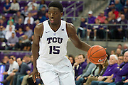 FORT WORTH, TX - FEBRUARY 6: JD Miller #15 of the TCU Horned Frogs brings the ball up court against the Kansas Jayhawks on February 6, 2016 at the Ed and Rae Schollmaier Arena in Fort Worth, Texas.  (Photo by Cooper Neill/Getty Images) *** Local Caption *** JD Miller
