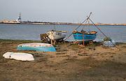 Fishing boats on beach Port of Felixstowe in distance, Harwich, Essex,