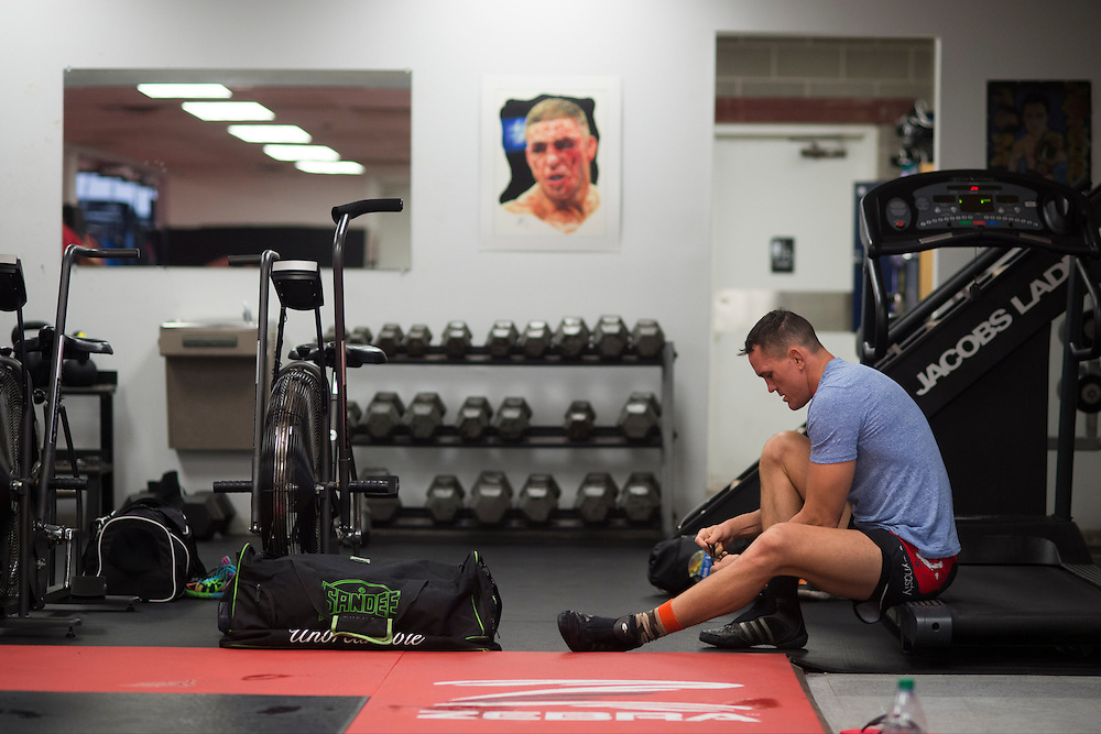 UFC welterweight Kyle Noke of Australia laces up his shoes before training at Jackson Wink MMA in Albuquerque, New Mexico on June 10, 2016.