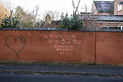 Poetic yet incorrectly written graffiti in Kings Heath on 31st December 2020 in Birmingham, United Kingdom. The slogan reads: A revolution without you, is a revolution not worth having.