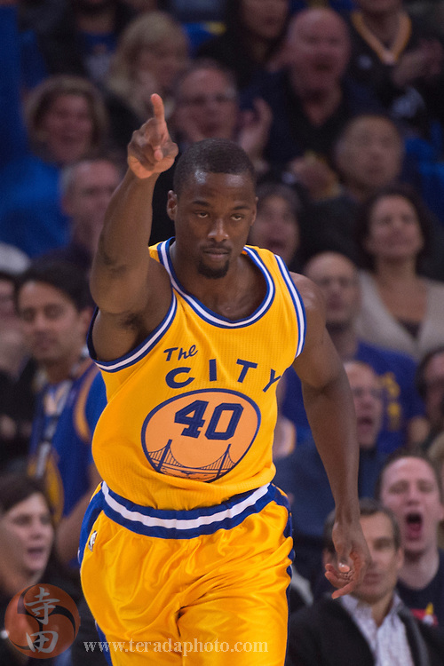 November 17, 2015; Oakland, CA, USA; Golden State Warriors forward Harrison Barnes (40) celebrates during the first quarter against the Toronto Raptors at Oracle Arena. The Warriors defeated the Raptors 115-110.