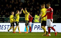 Burton Albion's players celebrate winning after the Carabao Cup, Fourth Round match at the Pirelli Stadium, Burton.
