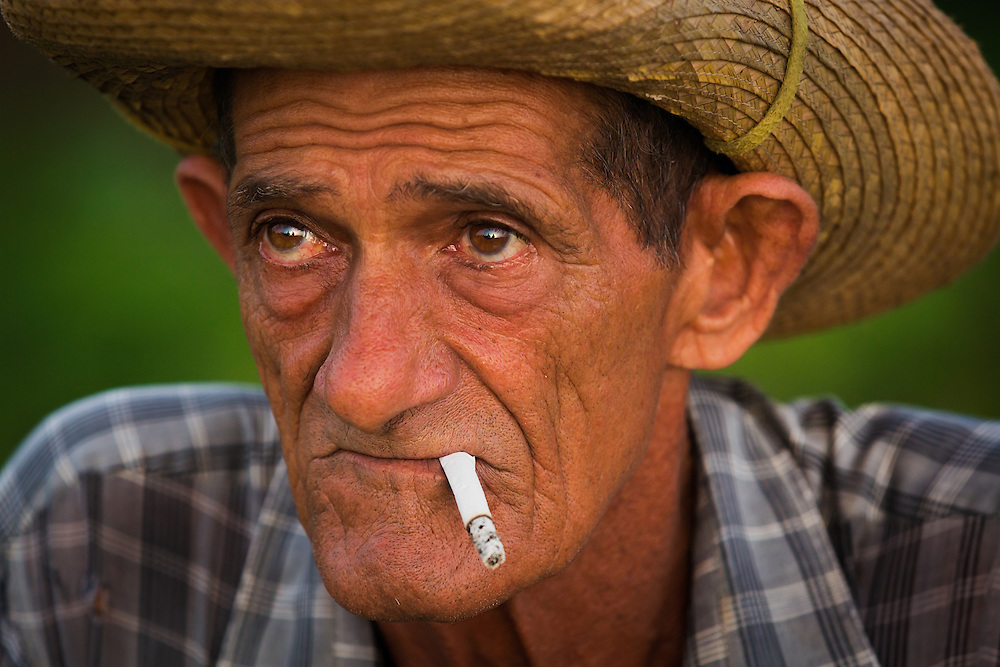Servilio Herrera, a guajiro in the Pinar del Río province of Cuba, takes a break after milking dairy cows.
